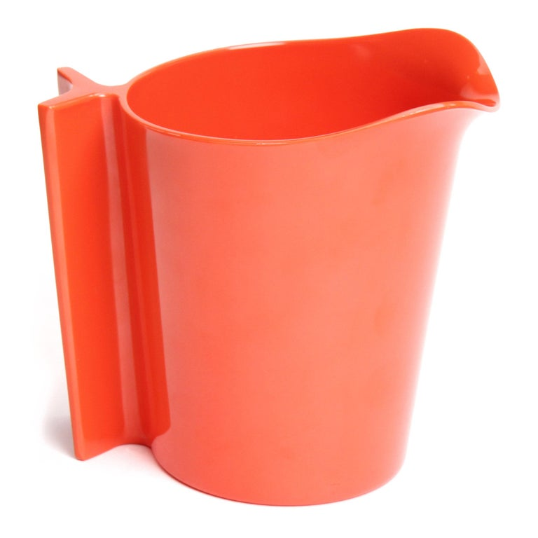 An expressive, uncommon and sculptural pitcher finely executed in vibrant orange plastic.