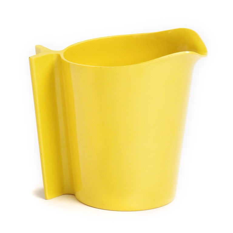An expressive, uncommon and sculptural pitcher finely executed in vibrant yellow plastic.
