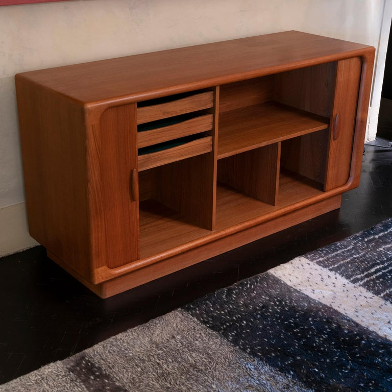 Danish design credenza or sideboard designed and produced by Dyrlund furniture makers in the 1960s, the organic shaped wood structure, two tambour doors that disappear completely when opened.