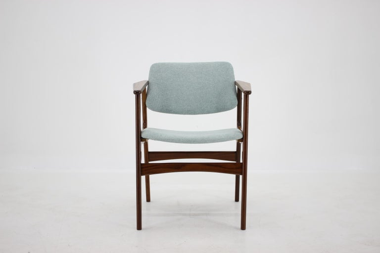 - Newly upholstered in light blue fabric - Wooden parts have been re-polished.