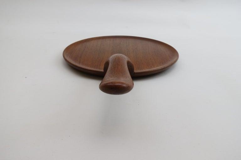 Teak serving tray from the 1960s, designed by Kay Bojesen  Stamped on the underside: Kay Bojesen, Denmark, Teak  St 834.