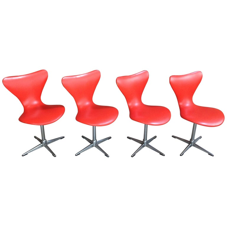 1960s Design Orange and Swivel Set of 4 Chairs For Sale