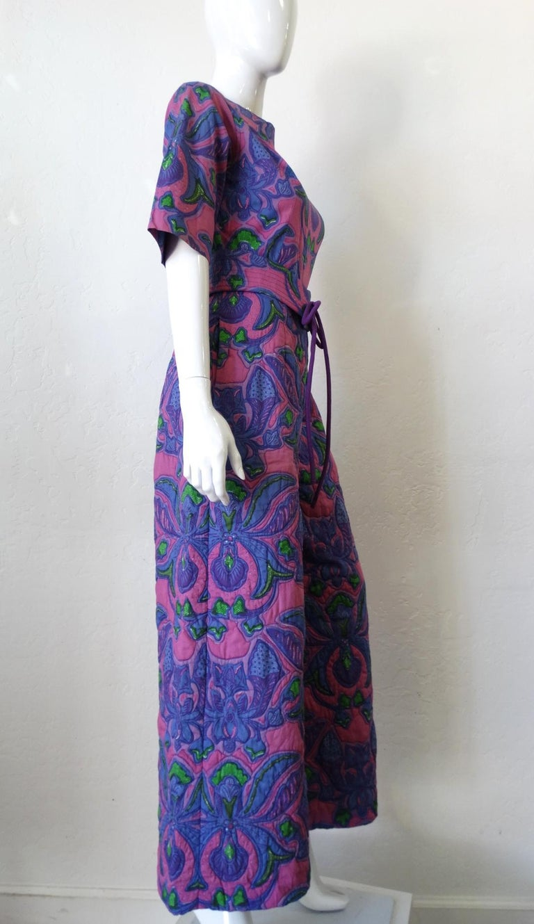 Channel You Inner 60s Girl With This Piece! Created by Design Thai, this 100% Cotton quilted jumpsuit features a floral psychedelic pattern which includes a combination of purples in contrast with blue and green. Includes inseam side pockets, a