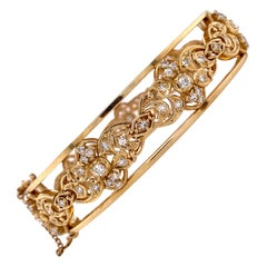 1960s Diamond 14 Karat Yellow Gold Hinged Bangle Bracelet Vintage