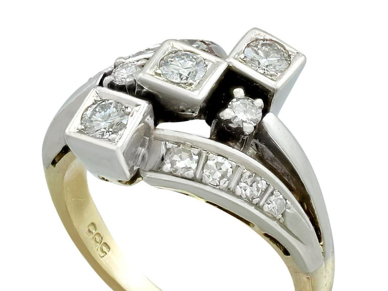 This fine and impressive vintage diamond dress ring has been crafted in 14ct yellow gold with a 14ct white gold setting.  The pierced decorated 14ct white gold twist design is ornamented with three transitional modern brilliant round cut diamonds,