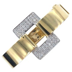 1960s Diamond Buckle Bangle Bracelet 18 Karat Yellow Gold