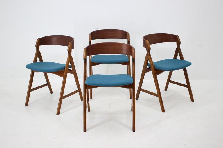 - Made of teak veneer and solid beech wood - Wooden parts have been repolished - Newly upholstered.