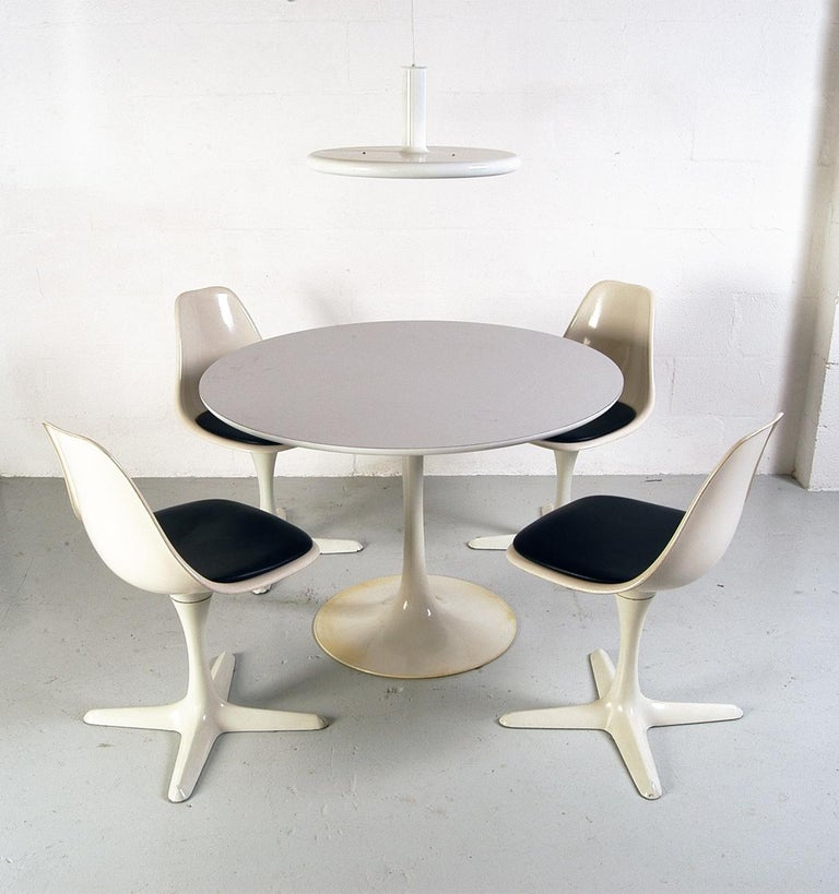 1960s Dining room suite by Maurice Burke for Arkana, Bath, England. This terrific 'Space Age' dining suite consists of the table and four matching chairs and would have been the height of fashion when new in the early 1960s. All four chairs rotate