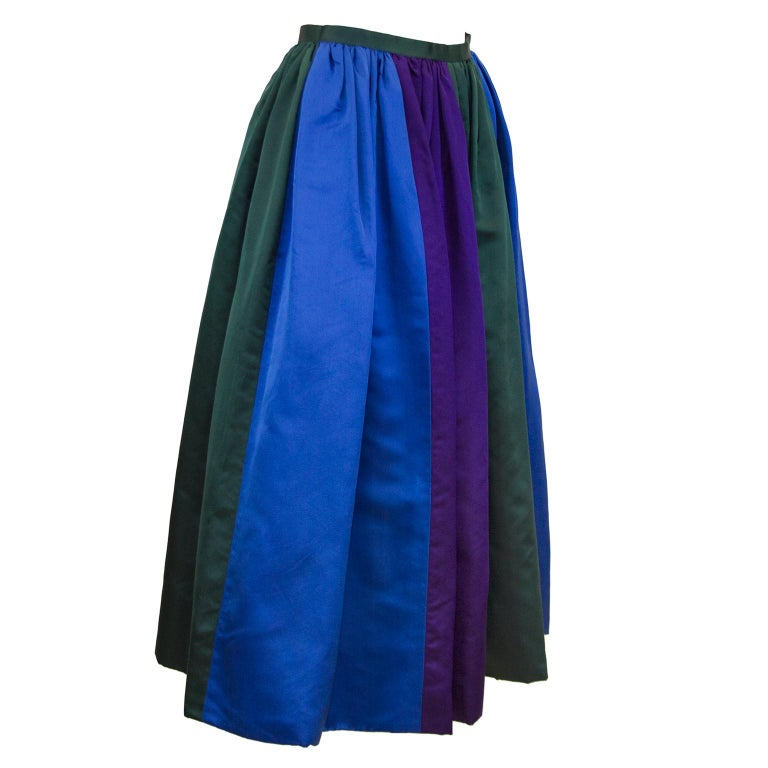 Designer unknown 1960's duchesse satin color block evening skirt in royal blue, hunter green and deep purple. Not quite floor length, fits average height woman lower calf to just above the ankle. In excellent condition, there is a label in the