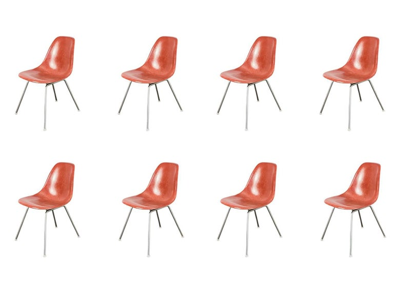 Original 1960s Eames terracotta fiberglass shell chairs with original H bases on narrow mount. The scarce terracotta colored shell has its original finish with distinct thread texture. All chairs are stamped. Additional base styles available,