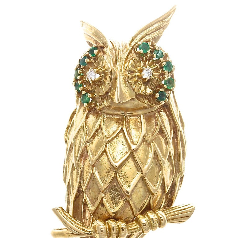 The fun and flair of the 1960's produced some of the most bold and whimsical jewelry.  This beautifully detailed 14k yellow gold owl brooch is adorned with approximately 0.50 carats of emeralds, approximately 0.10 carats of diamonds with G-H color,