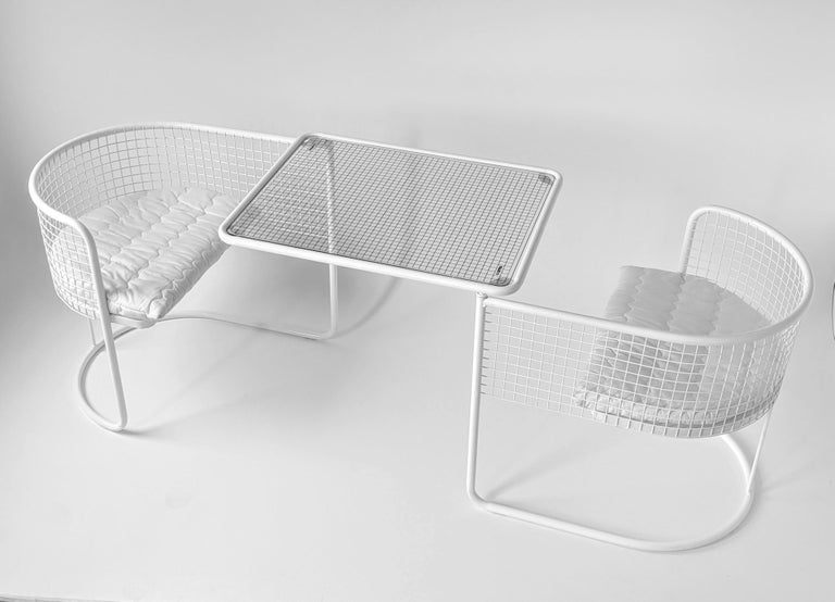 Practical wire chair that pivot under table to save space.  Designed for outdoor use. Could be use inside.   Original Rilsan Polymer finish that is resistant to corrosion, scratches and aging.   Measure: Open 76 in. wide x 29 in. deep x 28 in.