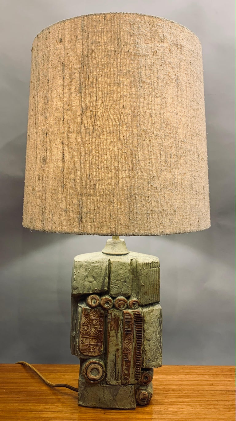 An unusual abstract ceramic table lamp designed by Bernard Rooke in England during the 1960s. This abstract and sculptural handmade piece in natural terracotta stone combined with both unglazed and glazed contrasting finishes. In excellent vintage