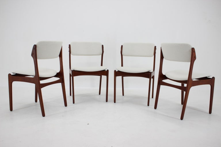 - Solid teak - Newly upholstered - Wooden parts have been refurbished - Labeled.