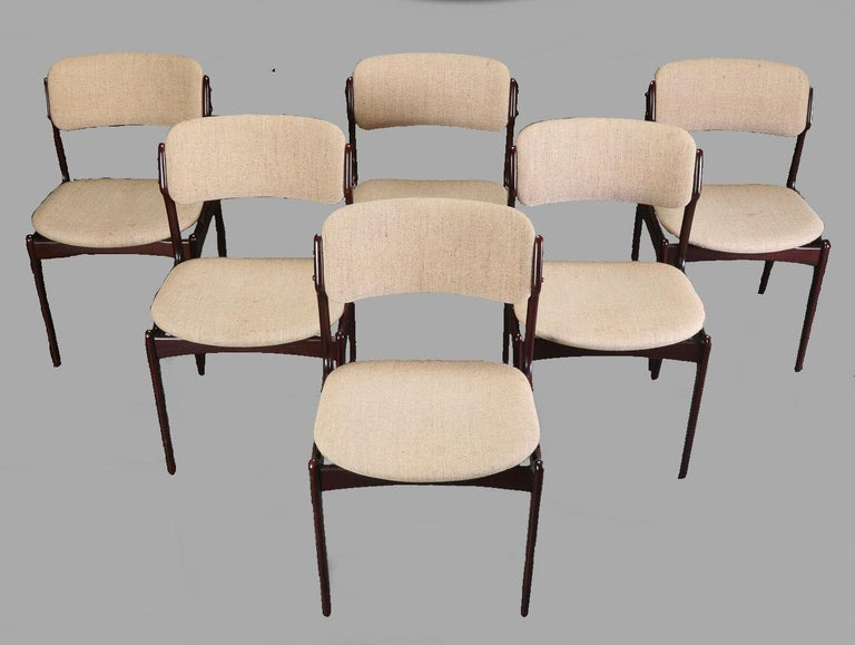 Set of six dining chairs in tanned oak with floating seat designed by Erik Buch for Oddense Maskinsnedkeri.  The chairs have a simple solid construction with elegant lines and a comfortable seating experience on the floating seat design that is