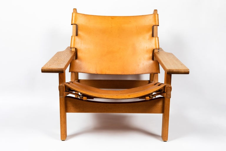 1960s Erling Jessen solid oak and cognac leather lounge chair. Executed in perfectly patinated cognac brown leather and richly grained solid oakwood. A quintessentially Scandinavian Modern chair by a master Danish designer whose exquisitely crafted
