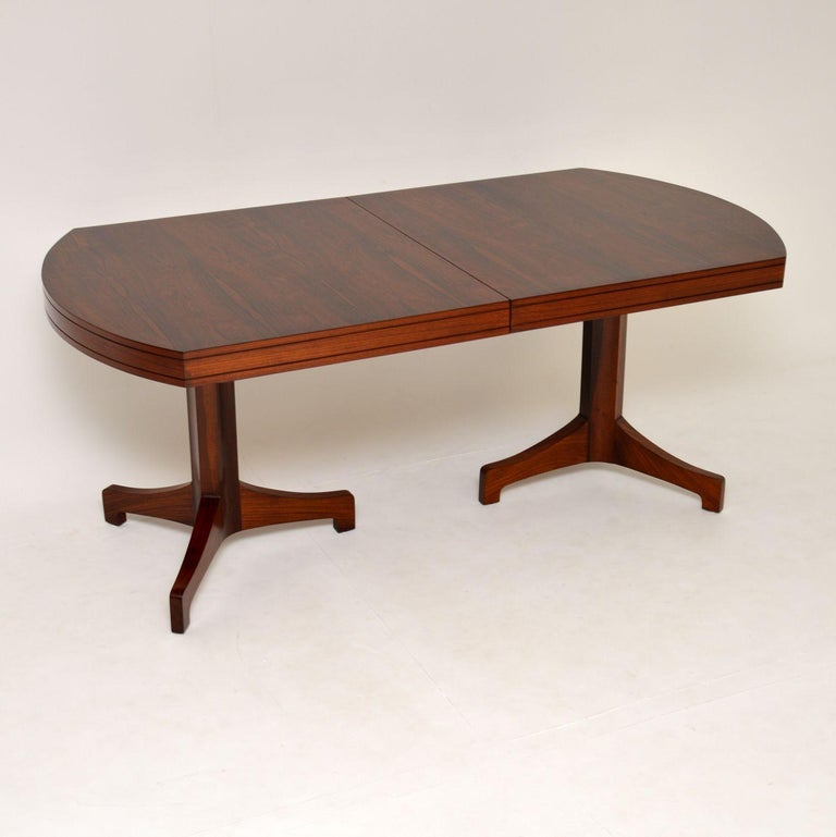 A stunning, exquisitely made and very rare vintage dining table. This was designed by Robert Heritage, it dates from the 1960s.  This is of the utmost quality, the wood grain patterns and color are absolutely stunning. There is an extra leaf that