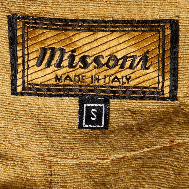 This is definitely the earliest Missoni label we have seen to date online or in person! We are dating this gorgeous dress to the very first years Ottavio and Rosita Missoni designed under the Missoni name during the early 1960s. The dress is mustard
