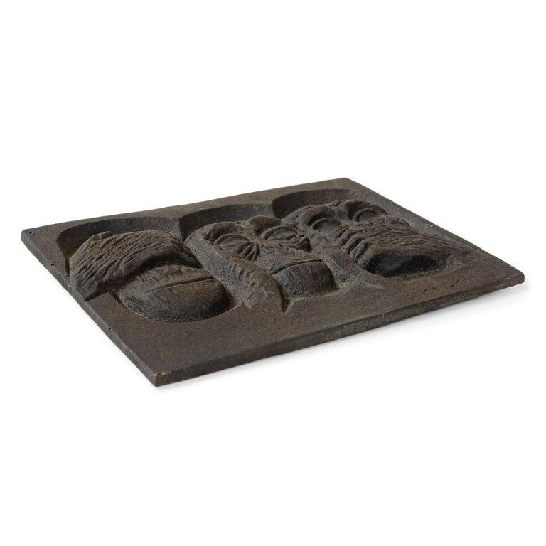 A cast iron plaque,