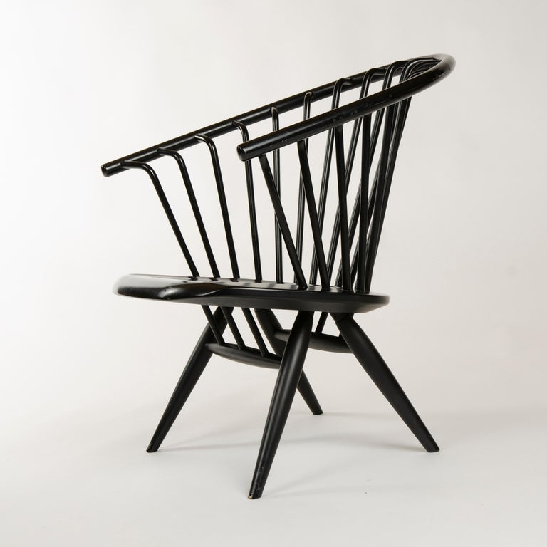 A pair of black painted birch 'Crinolette' lounge chairs with bent wood spokes tenon-joined to the solid bent back rest, maintaining original 'Asko Export' stickers.