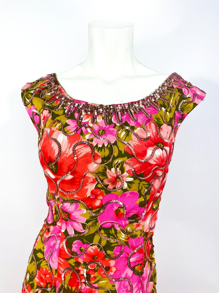 1960s custom full-length summer evening gown featuring a vibrant floral print with rose pink sequin accents thought out the entire dress and densely sequined along the neckline.