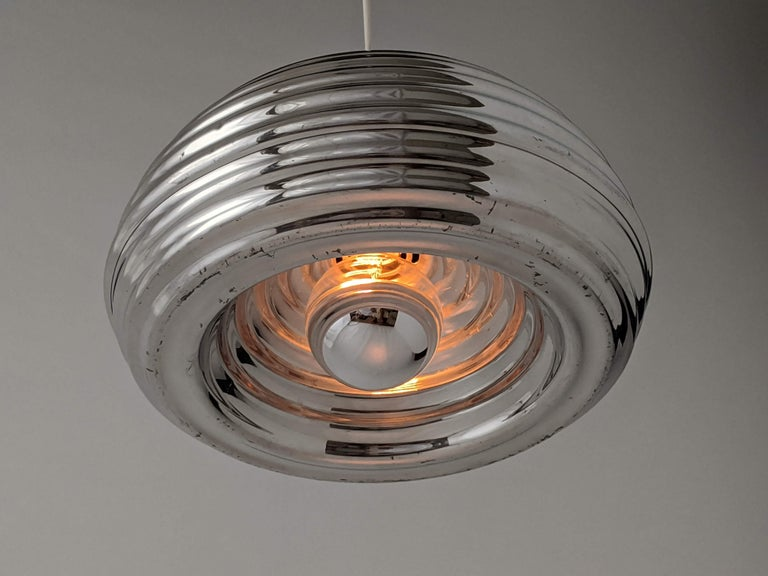 Original non lacquered early edition of this intriguingly designed pendant made of polished aluminium. 