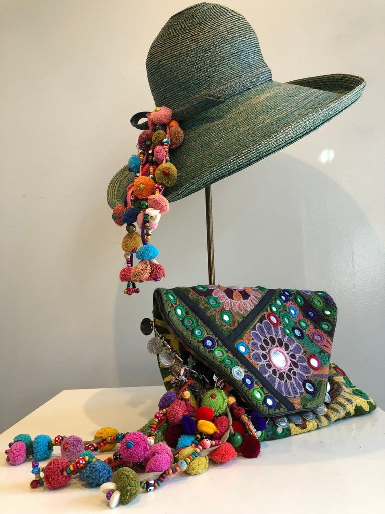 1960s Frank Olive Jade Green Straw Hat & Moroccan Textile Boho Clutch. This 2-piece set starts out with a superb Frank Olive hat in an unusual color and adds a splash of Moroccan-style pom-pom, coin trim and mirror ornamentation on the hat and