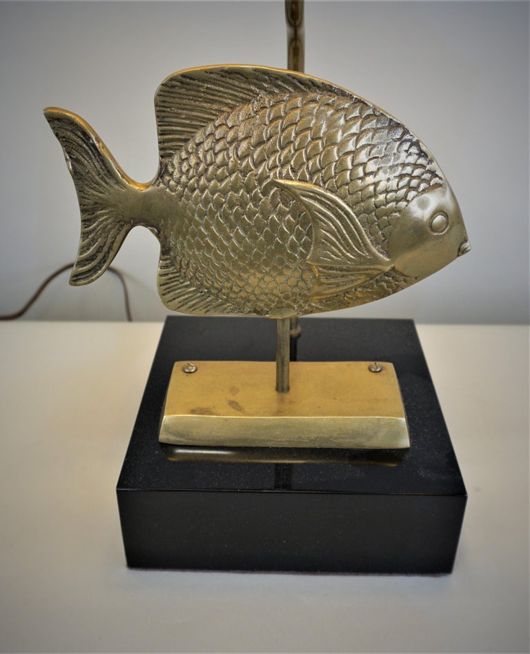 Customized 1960s from beautiful bronze fish with black lacquer base and oblong bell shape lampshade.