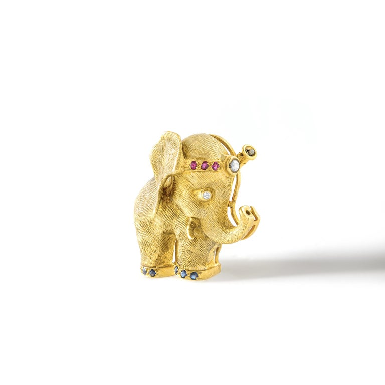 1960S French Diamond Ruby Yellow Gold 18k Elephant Brooch Clip. The Elephant is considered a symbol of good luck, power, success wisdom and experience.  Size: 1.18 x 1.18 inch (3.00 x 3.00 centimeters).  We are reknown for curating unfindable