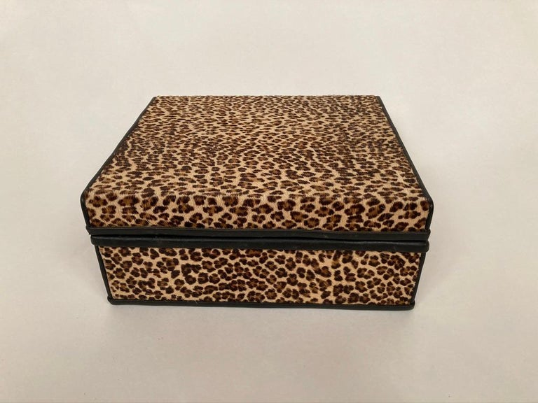 A midcentury French box covered in leopard skin with black leather trim and an interior of black dyed lizard skin. With beautiful brass hinges, a bespoke item of admirable craftsmanship. Very much of the 1960s era, brings to mind Bob Dylan's song