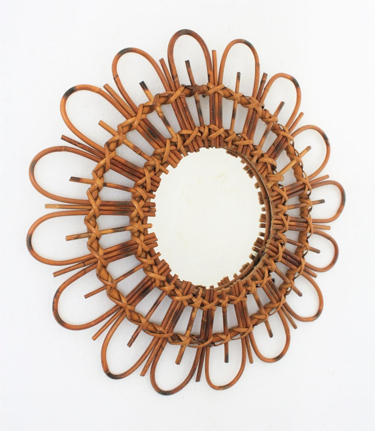 Beautiful French flower burst mirror made in rattan and bamboo with pyrography decorations. Lovely to place it alone or creating a wall decoration with other rattan or bamboo mirrors. France, 1960s. Measures: Glass diameter 22cm.