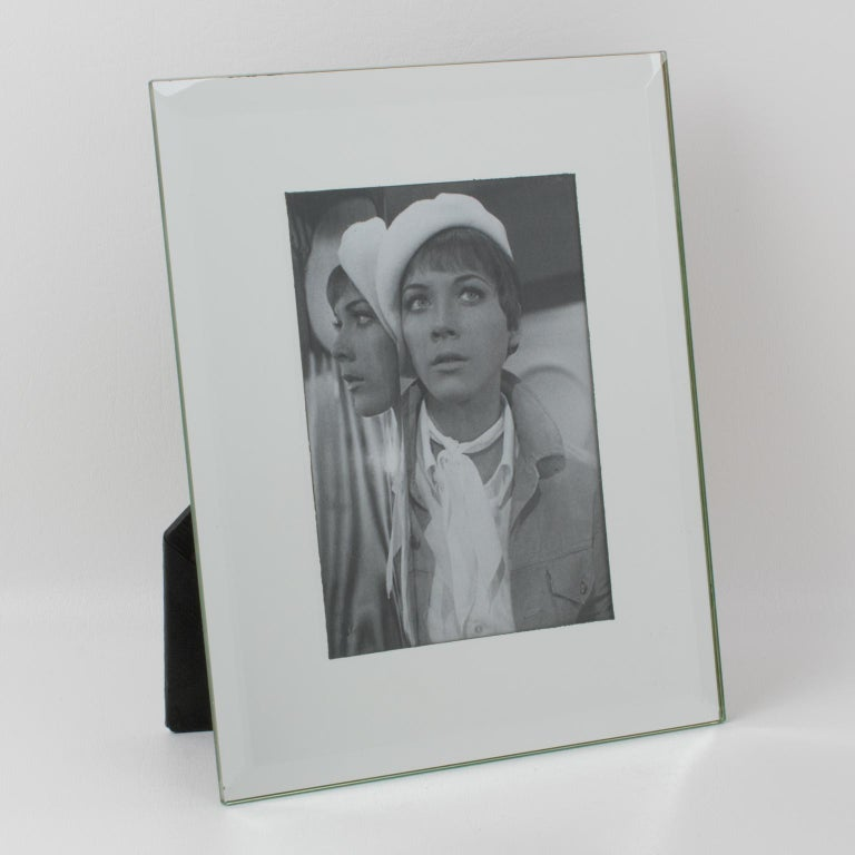 Lovely French mirrored glass picture photo frame. Silver mirror beveled edges. Picture frame can be placed in portrait or in landscape position. Back and easel in mat black paper. Marked at the back