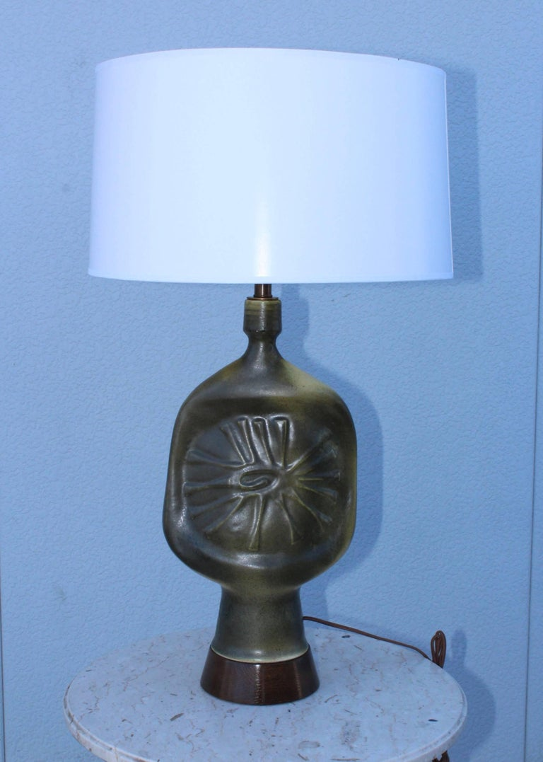 Stunning 1960s modern French pottery with wood base and brass hardware, newly professionally rewired and ready to use.  Height to light socket 24.5