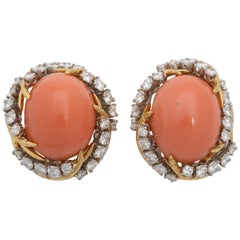 1960s, French, Oval Cabochon Coral with Diamonds Textured Gold Swirl Earclips