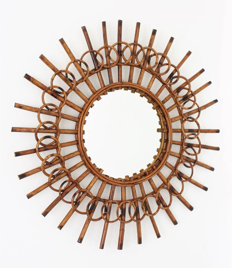 Hand-Crafted 1960s French Riviera Mid-Century Modern Rattan Sunburst Mirror Framed by Circles For Sale