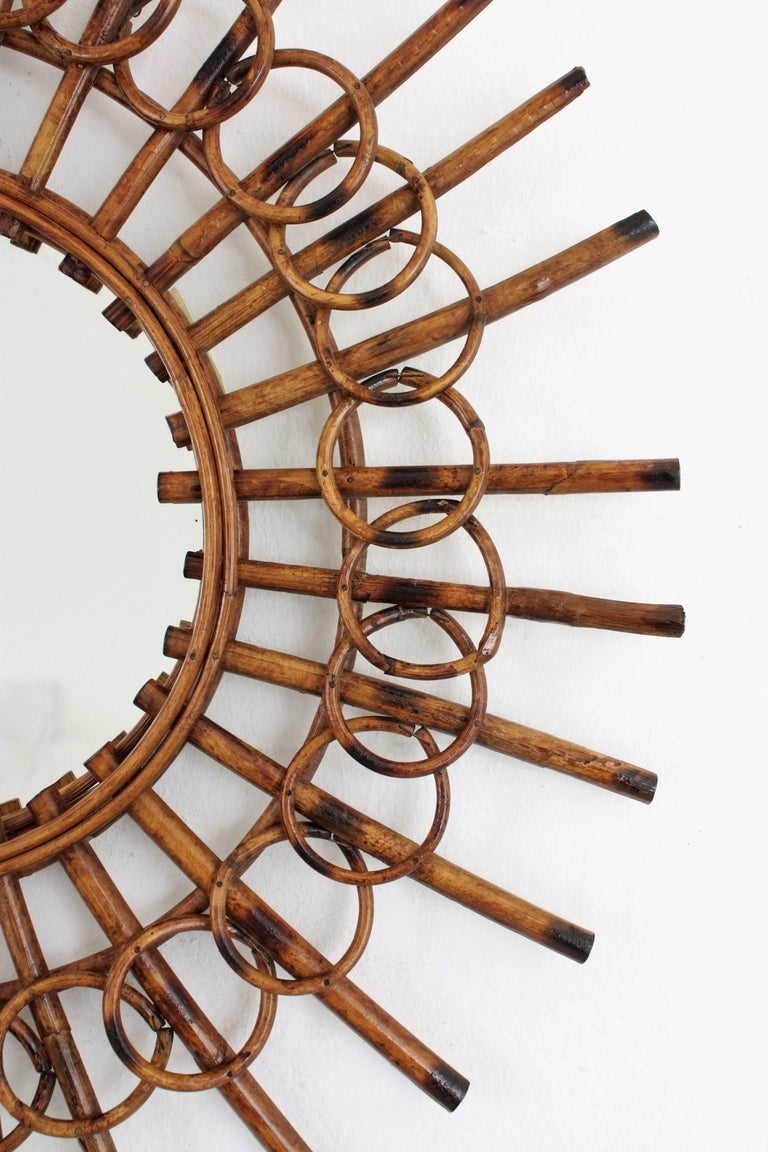 Cane 1960s French Riviera Mid-Century Modern Rattan Sunburst Mirror Framed by Circles For Sale