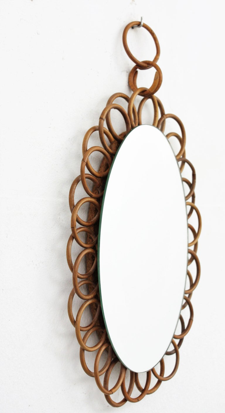 20th Century 1960s French Riviera Rattan Flower Shaped Hanging Oval Mirror For Sale