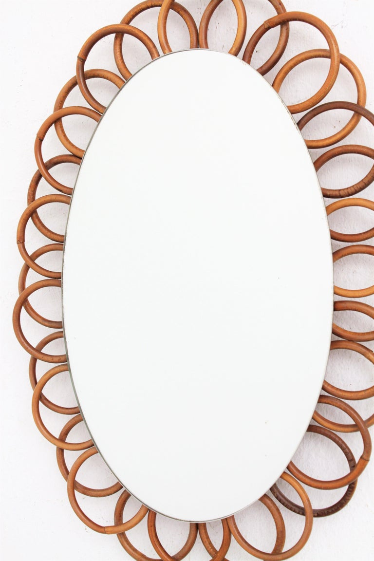 1960s French Riviera Rattan Flower Shaped Hanging Oval Mirror For Sale 1