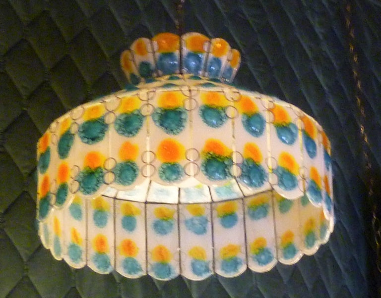 With it's classic stained glass pendant draped shape, this Pendant Chandelier in the style of Michael and Frances Higgins is made with Fused Art Glass panels. Beautiful crown top. Fresh sunshine colors, perfect for the breakfast nook. Completely