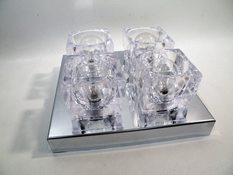 Square four-light flush mounted sconce or ceiling lamp by Gaetano Sciolari, dating to the 1960s. This original example has four square crystal cubes on chrome-plated steel mounting plate. Listed price is per fixture or lamp. Can be hung on ceiling