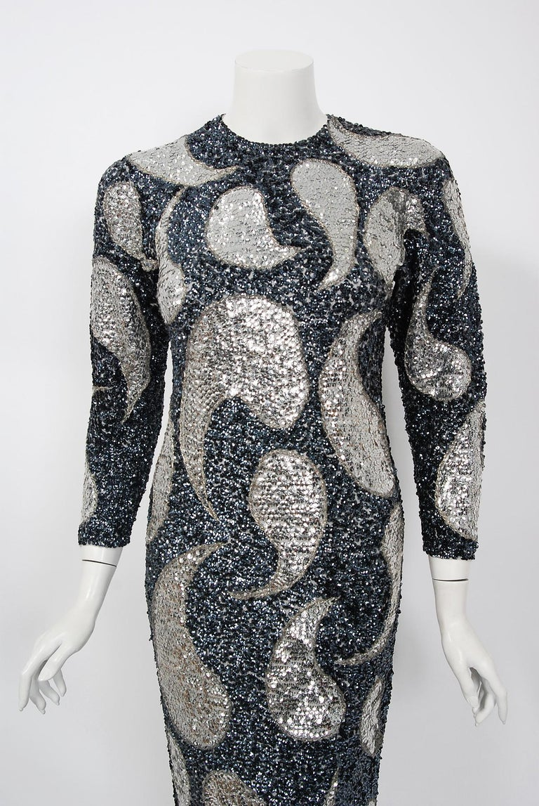 Mid-century Gene Shelly designer garments are in a class of their own. They are always fully-sequined by hand and fit to flatter the figure. This early 1960's treasure has a fantastic graphic paisley design worked in, featuring iridescent-beadwork.