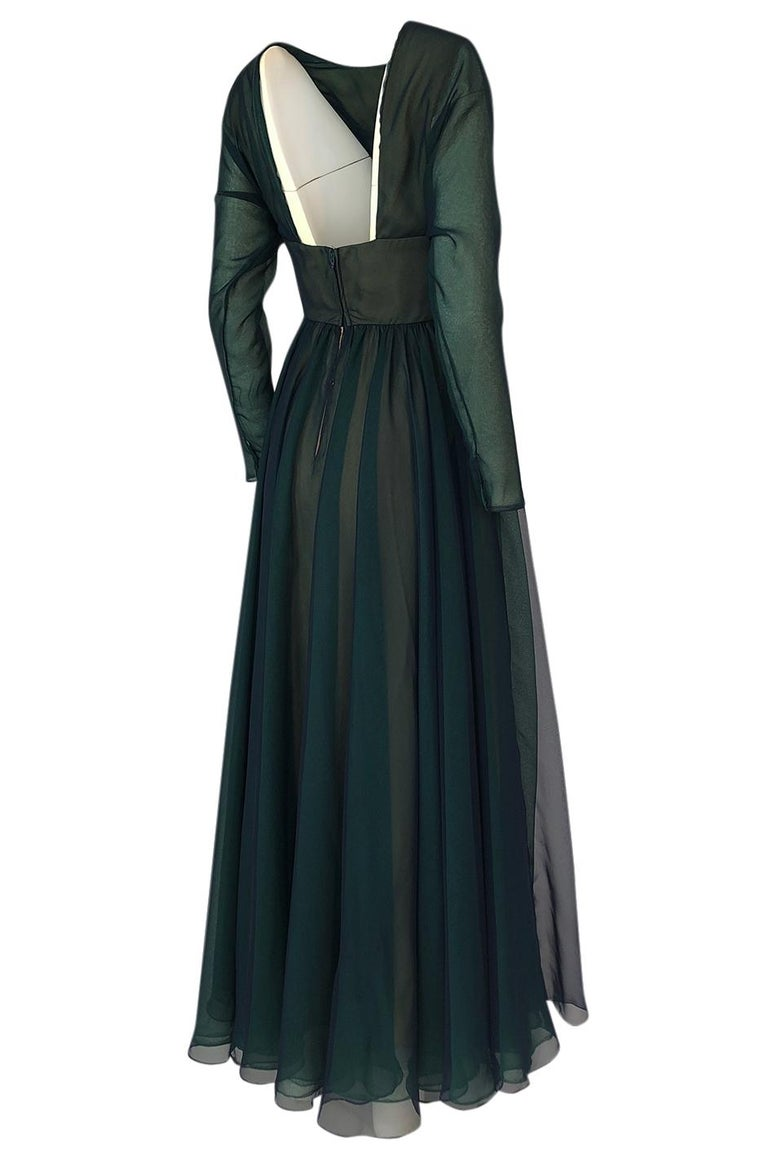 I have this same dress in a brown version that is also currently available in the shop. If you want to see it in that color option, please send me a note.  Geoffrey Beene's evening wear rarely misses the mark.  It always has this combination of
