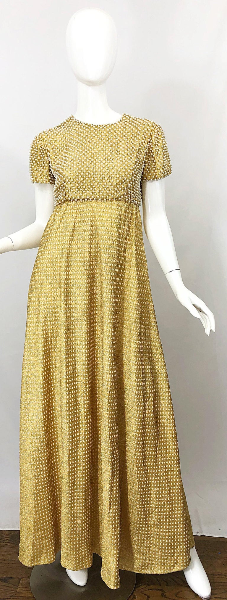 Musuem quality rare 1960s GEOFFREY BEEN gold silk metallic pearl encrusted short sleeve gown! Features hundreds of hand-sewn ivory pearls throughout the entire bodice. Gold silk lurex features white polka dots throughout. Hidden metal zipper up the