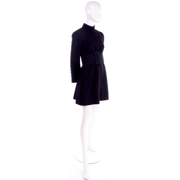 We love Geoffrey Beene and this is an iconic Geoffrey beene dress from the 1960's. This black wool mini dress has an oversized matching black thick belt. This dress fits like a 4/6 in a tent or swing style and can be worn with or without the belt. .