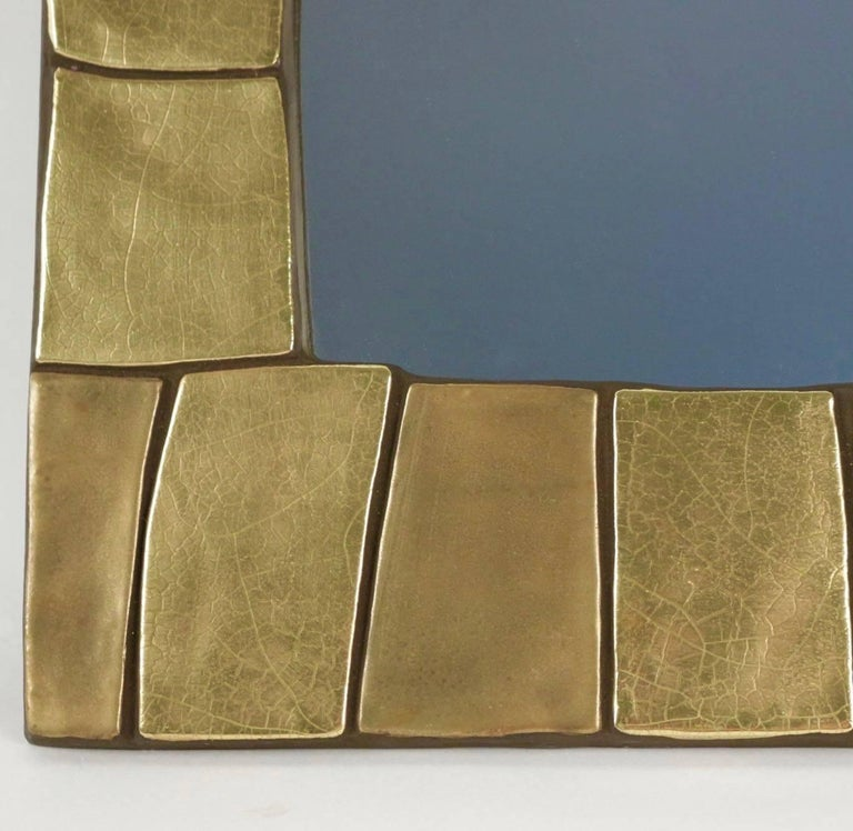 1960s gilded and enameled ceramic mirror, by Mithé Espelt   The frame is composed by gilded and enameled ceramic tiles of different shades and textures.