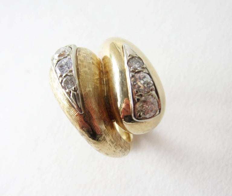 14k gold and diamond cross hatched bypass ring, circa 1960's.  Ring is a finger size 6.5 and is signed 14k.  In very good vintage condition.  12.3 grams.