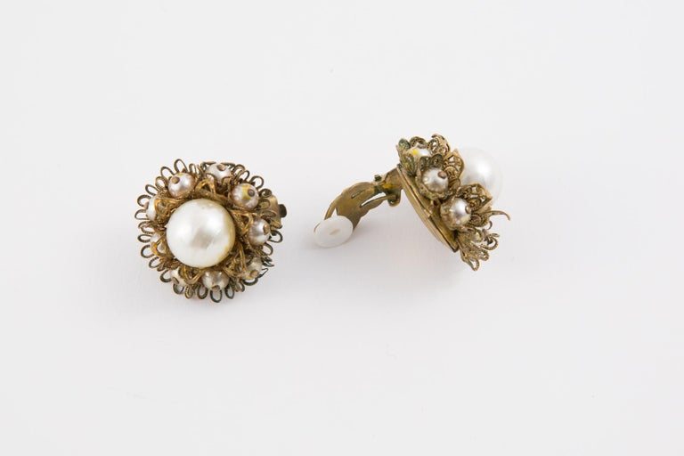 3cm X 3cm  diameter 1960s gold tone clip on earrings featuring faux pearls beads, a back clip fastening.   In good vintage condition  Made in France.  These earrings come as a pair.  Width diameter: 1.5in. (4cm)  We guarantee you will receive this