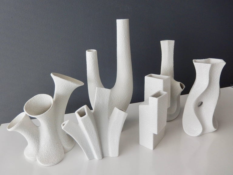 A group of six white porcelain vases by the innovative designer Peter Muller for Sgrafo Modern of West Germany.  In 1955 two brothers, Peter and Klaus Muller opened a small porcelain factory in Germany and created some of the most modern,
