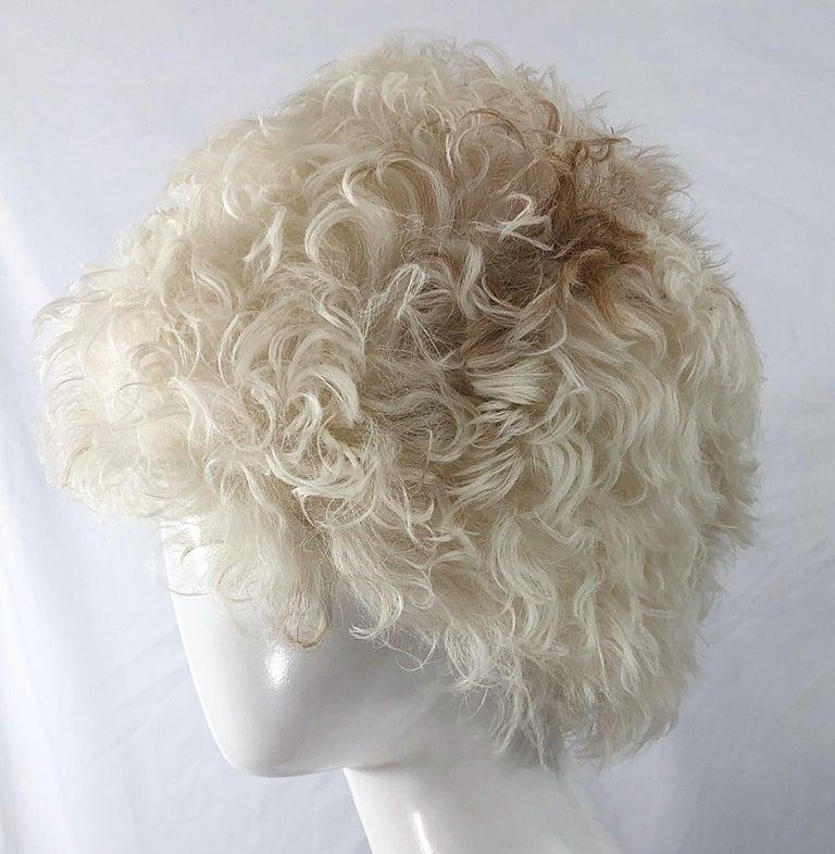 Chic and super rare early 60s HALSTON Mongolian lamb fur hat and matching muff ! Jackie O Kennedy wore a Halston hat and muff to the 1961 presidential inauguration, making Halston a fashion celebrity. Features ivory with natural brown and tan