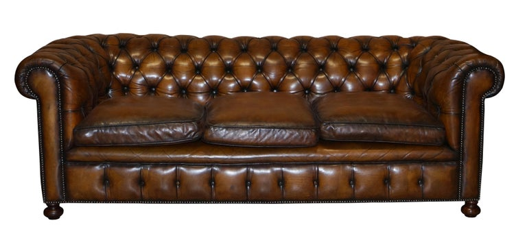 We are delighted to offer for sale this exceptionally rare original 1960's Cigar brown leather Chesterfield club sofa in restored condition with feather filled cushions   This is a very rare find, you almost never come across mid 20th century